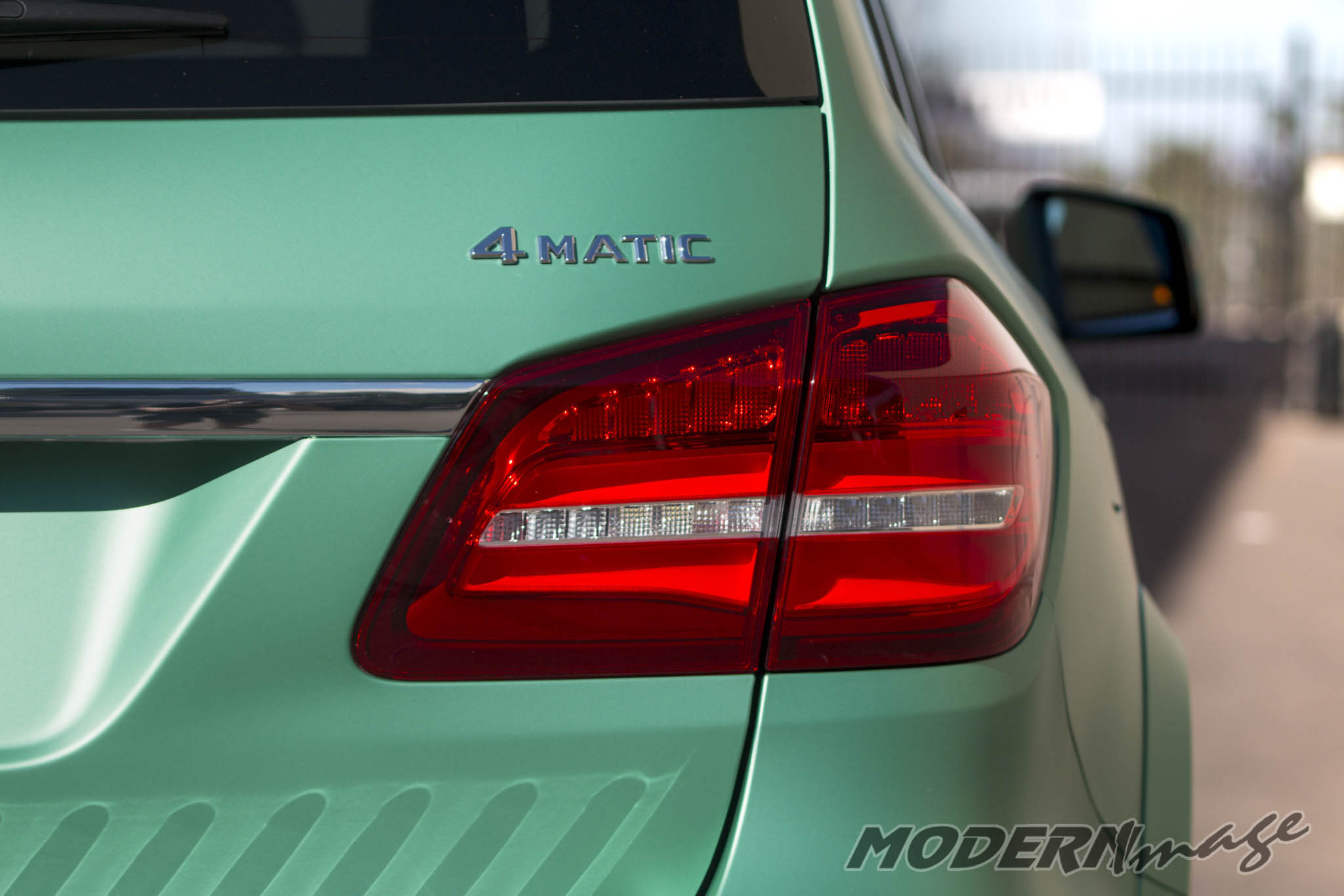 Modern image mercedes gls500 satin emerald green wrap 11 for Emerald satin paint